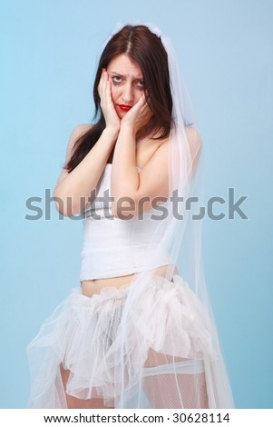 despondent young bride with running make up