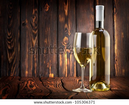 Desser white wine on the table - stock photo