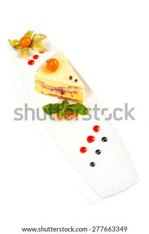 Dessert - Cake with Berries Sauce and Green Mint - stock photo