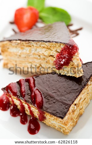 Dessert - Chocolate Nuts Cake with Berries Jam, Strawberry and Fresh Mint - stock photo
