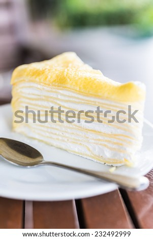 Dessert crepe cakes in white plate - selective focus