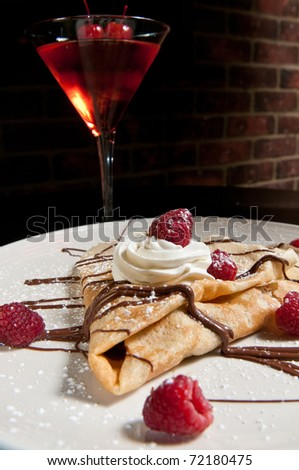 Dessert crepe with fresh raspberries, whipped cream and chocolate - stock photo