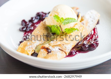 dessert crepe with ice cream and blueberry - stock photo
