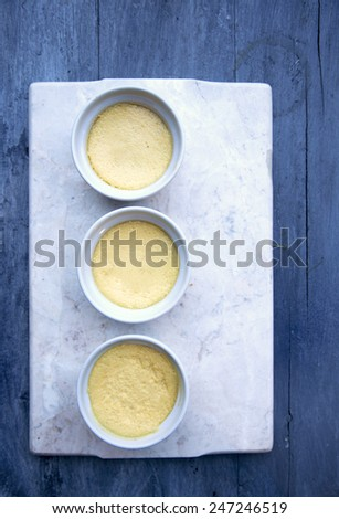 Dessert/custard cream cup on white marble and Blue Background - stock photo