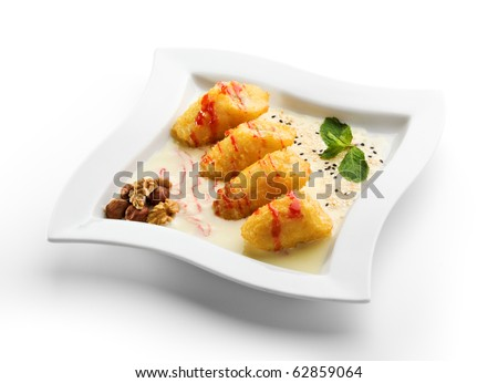 Dessert - Deep Fried Banana Slice with Vanilla Sauce and Honey Nuts - stock photo