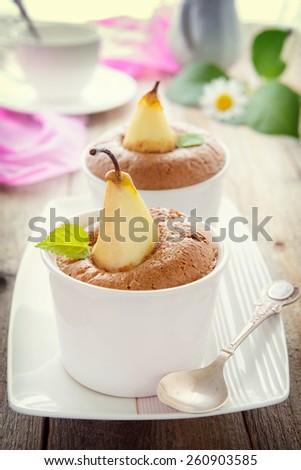 Dessert from baked pear and sponge-cake. Filtered image - stock photo