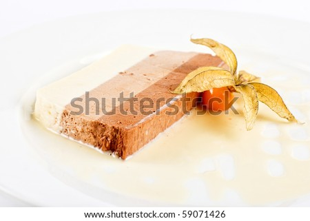 dessert from three different kind of chocolate with ground-cherry closeup on a white - stock photo