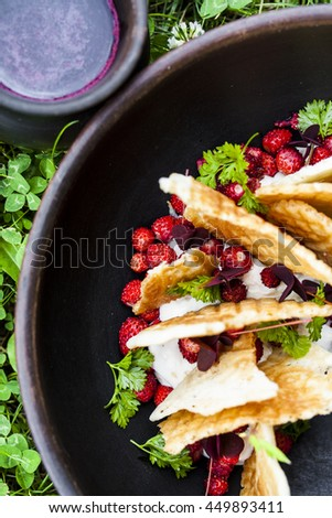 dessert made with wild strawberries, cream cheese and waffles - stock photo