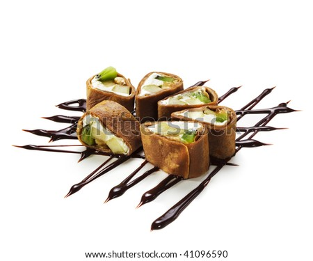 Dessert Maki Sushi - Chocolate Roll with Various Fruit and Cream Cheese inside. Chocolate Pancake outside. Served on Chocolate Pattern - stock photo