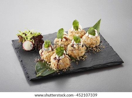 Dessert Maki Sushi - Chocolate Roll with Various Fruit and Cream Cheese inside. Pancake outside. Served with Chocolate Crumb