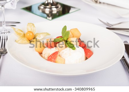 dessert of ice cream with fruit and jam. restaurant meals