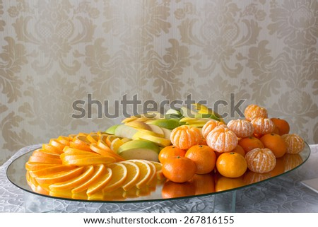 dessert of oranges and apples - stock photo