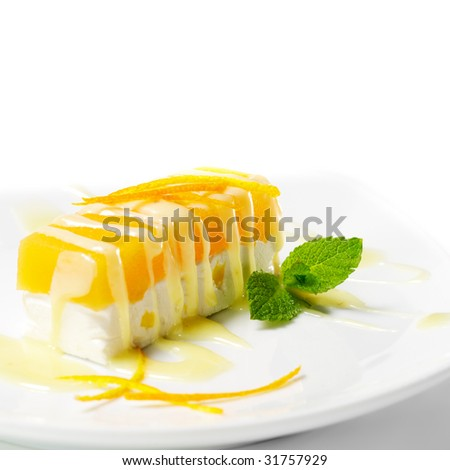 Dessert - Orange Cheesecake with Fresh Mint - stock photo