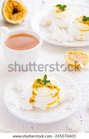 "Dessert ""Pavlova"" of meringue with passion fruit. - stock photo"