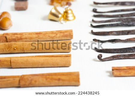 dessert spices in a row on white wooden table background