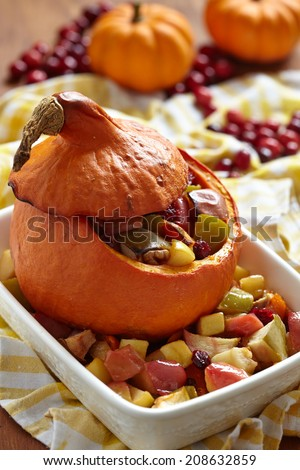 Dessert Stuffed pumpkin with fruits for Thanksgiving - stock photo