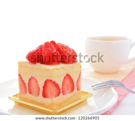 Dessert - sweet cake with strawberry on a plate with white copy space - stock photo