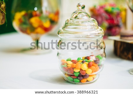 Dessert Sweet Tasty Yummy Colorful Glazed Nut Candies in Candy Bar On Table. Delicious sweet buffet - stock photo