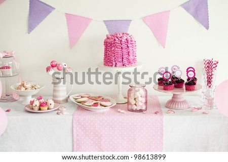 Dessert table for a party - stock photo