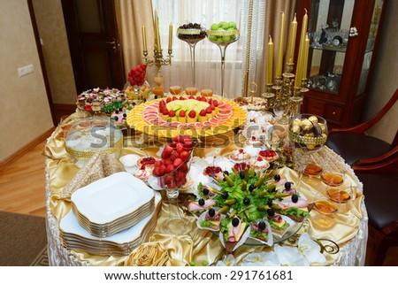 Dessert table setting - stock photo