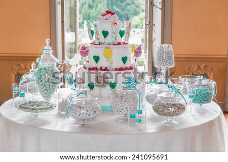 Dessert table with cake and candy on a wedding day - stock photo