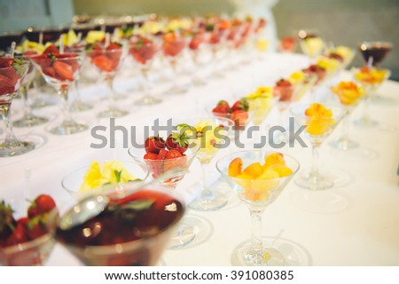 dessert table with fruit glasses - stock photo