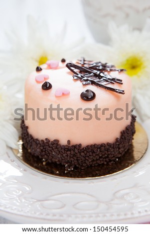 Dessert - tasty sweet pink cake on a white wooden background - stock photo