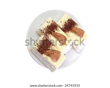 Dessert -three sponge cakes  on white plate . Top view. Isolated. - stock photo