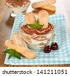 dessert tiramisu on a brown table - stock photo
