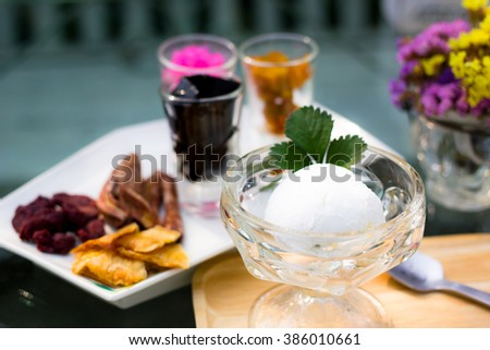 Dessert with coconut ice cream homemade and topping organic dried fruits - stock photo