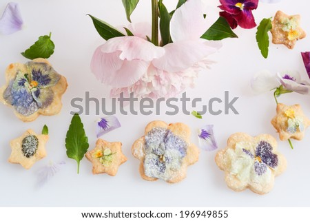 dessert with edible flowers - stock photo