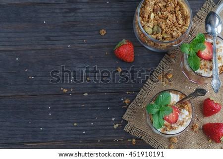Dessert with fresh berries, cottage  cheese, granola and berries jam - stock photo