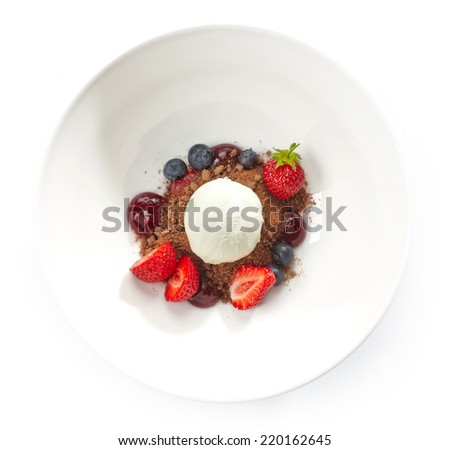 Dessert with ice cream and fresh berries isolated on white - stock photo