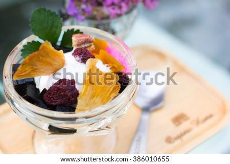Dessert with ice cream homemade topping organic fruits - stock photo