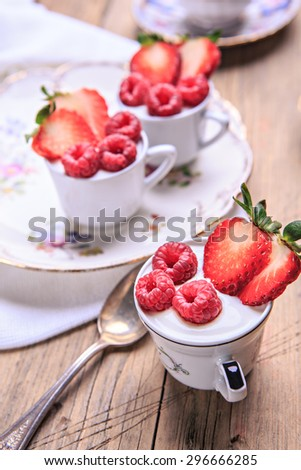 dessert with raspberries and strawberries in rural style
