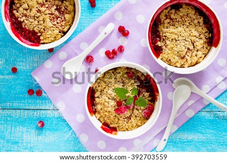 Dessert with red currant crumble, selective focus.