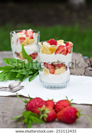 Dessert with strawberries.Cheese, strawberry, banana, cornflakes on the table. Breakfast. - stock photo
