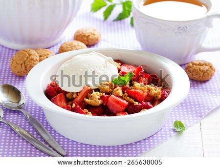 Dessert with strawberries, whipped cream and cookies.