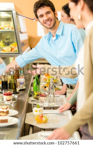 Desserts at cafeteria people with serving tray self service canteen - stock photo