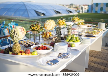 Desserts table/cakes/fruits/buffet