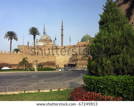 destination castle with garden and palms in Africa, Egypt - stock photo