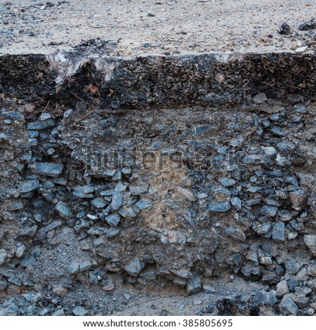 destroy asphaltic concrete highway show cross section of highway - stock photo