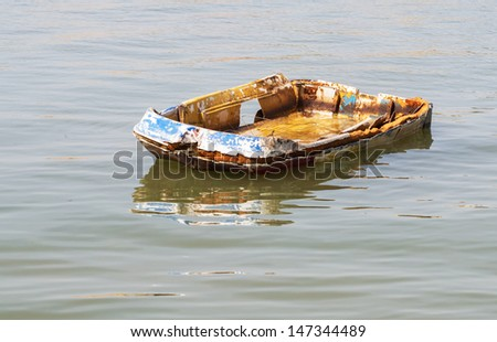 destroyed an abandoned plastic boat on the river, Belgrade, Serbia - stock photo