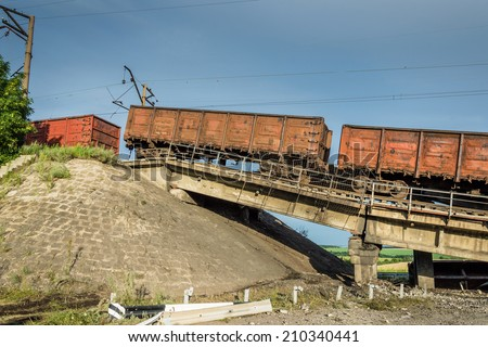 Destroyed bridge with wagons after the explosion terrorists - stock photo