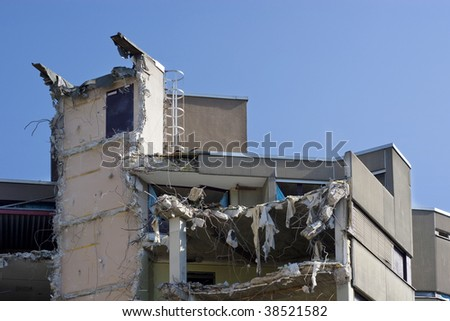 Destroyed building, can be used as demolition, earthquake, bomb, terrorist attack or natural disaster concept - stock photo