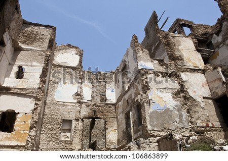 Destroyed building, demolition, earthquake, bomb, terrorist attack or natural disaster - stock photo