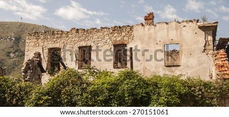 Destroyed building during the Bosnian war. Mostar, Bosnia & Herzegovina - stock photo
