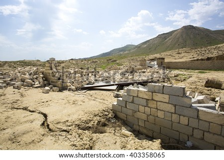 Destroyed building - rubble. Ruined destroyed house - stock photo