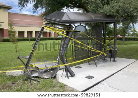 Destroyed city bus stop shelter due to driver losing control of his vehicle - stock photo