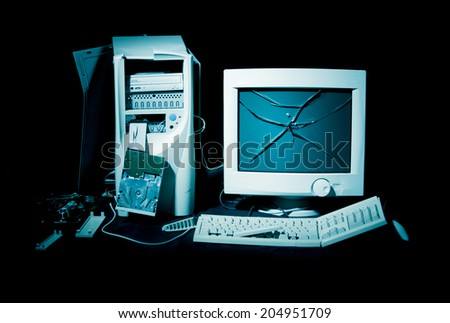 Destroyed computer on black background - stock photo